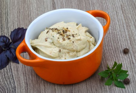 Photo for Traditional arabic cusine - hummus with herbs, olive oil and spices - Royalty Free Image