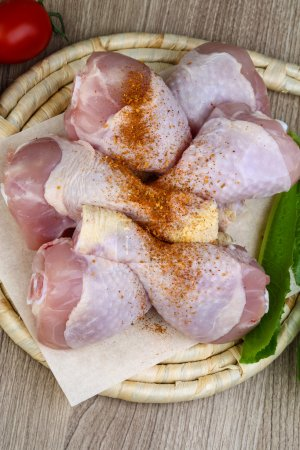 Raw chicken legs with garlic
