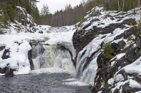 Waterfall Kivach in winter. Karelia, Russia.