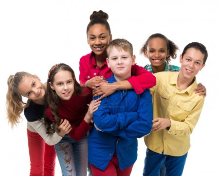 Group of children with different complexion embracing