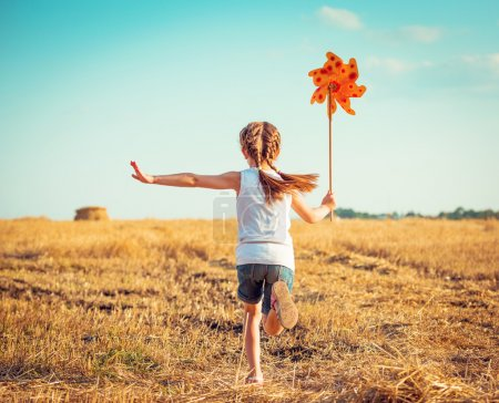 cute little girl with a  windmill