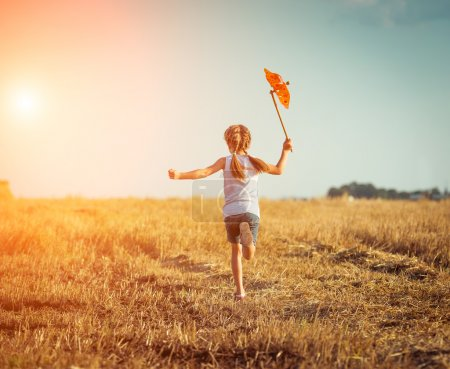 Photo for Happy cute little girl with a windmill - Royalty Free Image