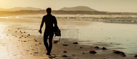 Surfer on ocean beach