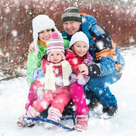 Photo for Winter portrait of happy young family of 4 people - Royalty Free Image