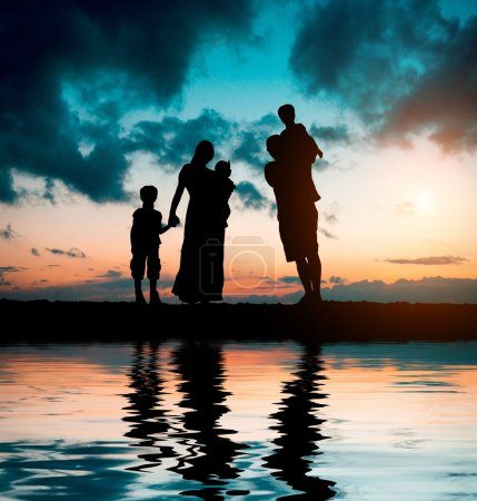 Family on  background of magnificent sunset