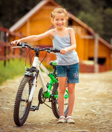 Photo for Little girl with her bicycle in rural areas - Royalty Free Image