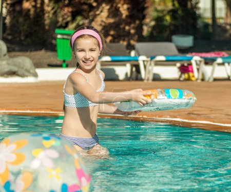 little girl  in the pool