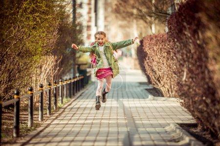 Little girl running  from school