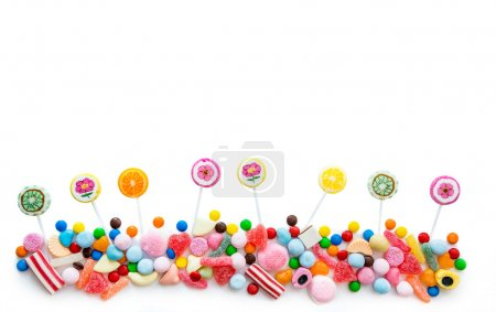 Photo for Arrangement of a variety of sweets on a white background - Royalty Free Image