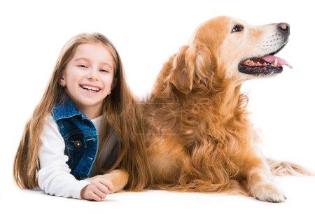 Happy little girl with retriever  dog