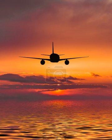 plane flies over the sea