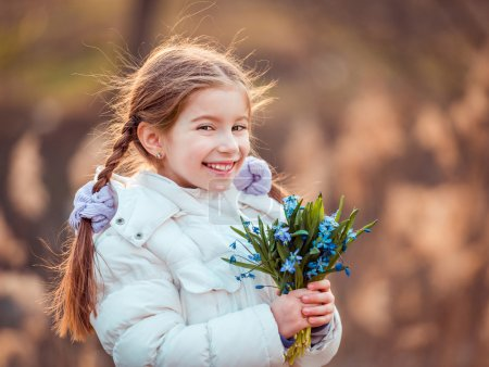 Little girl with  snowdrops