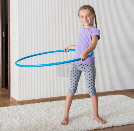 Smiling girl  with hula hoop a