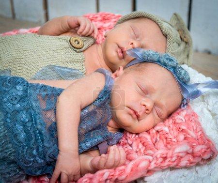 newborn twins l sleeping in a basket