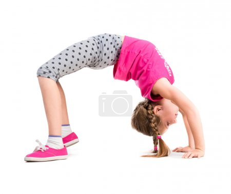 little girl doing the bridge exercise