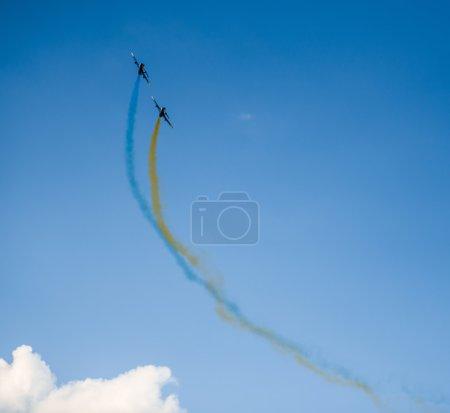 airplanes  with colorful smoke of ukrainian flag