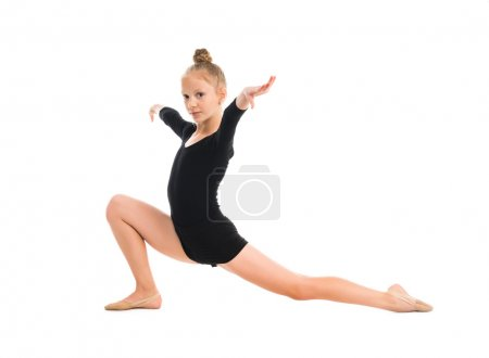 little gymnast stretching on  floor