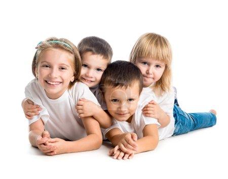 smiling children lying on  floor