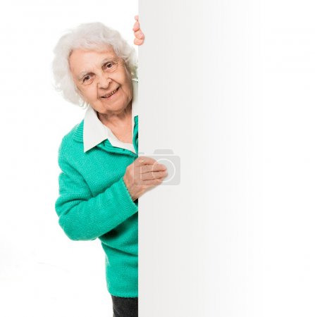 Photo for Elderly woman alongside of ad board over white background - Royalty Free Image