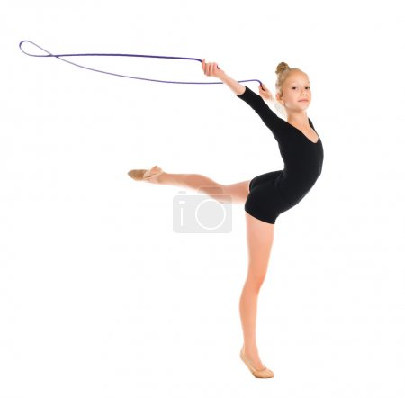 little gymnast doing exercise with skipping rope
