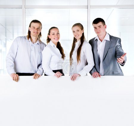 Business team holding  large blank