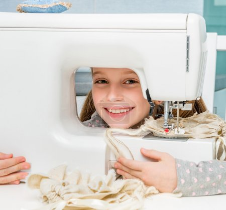 little girl  with sewing machine