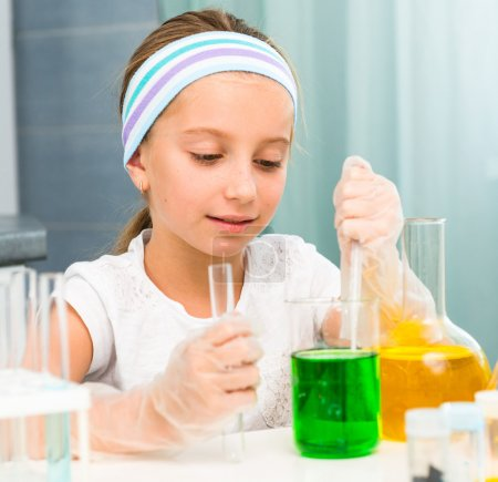 Photo for Cute little girl with flasks for chemistry - Royalty Free Image