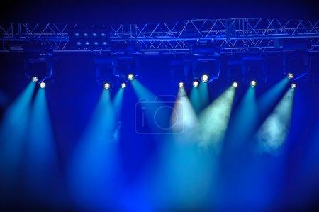 Blue spotlights on stage