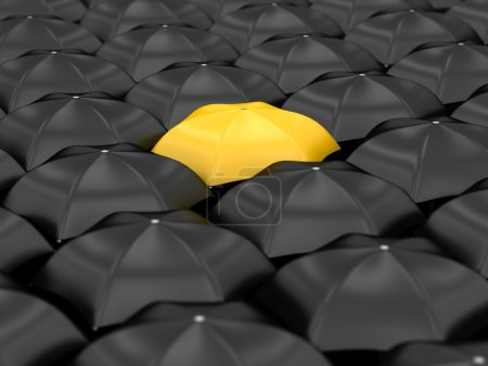 Photo for Unique yellow umbrella with many black umbrellas - Royalty Free Image