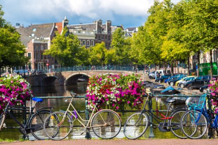 Bicycles on a bridge over canals