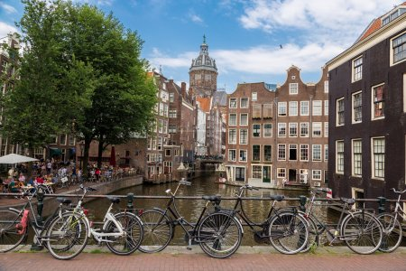 Bicycles on  bridge over canal of Amsterdam