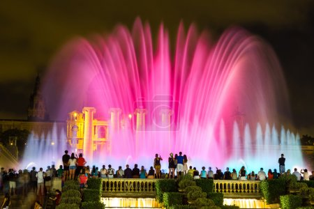 Magic Fountain light show at night next to Nationa...