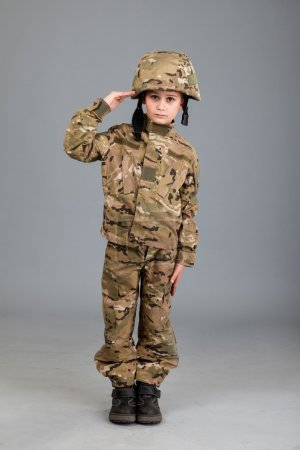 Young boy dressed like soldier