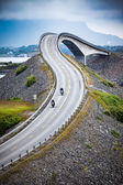 Atlantic Ocean Road Two bikers on motorcycles.