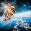 Astronaut in outer space against the backdrop of t...