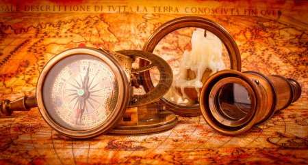 Photo for Vintage still life. Vintage magnifying glass lies on an ancient world map in 1565. - Royalty Free Image