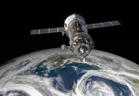Spacecraft Soyuz over the planet earth