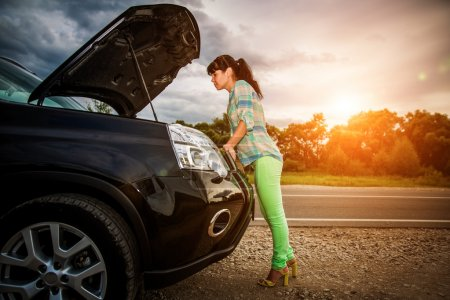 Photo for Woman on the road near the car. Damage to vehicle problems on the road. - Royalty Free Image