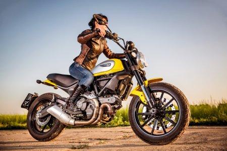 Biker girl on a Scrambler