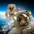 Постер, плакат: Astronauts in outer space