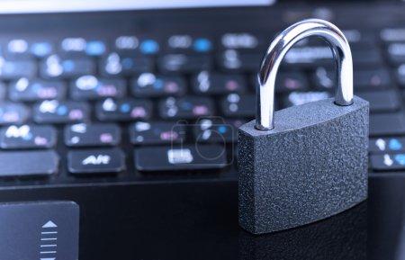 padlock on laptop computer keyboard