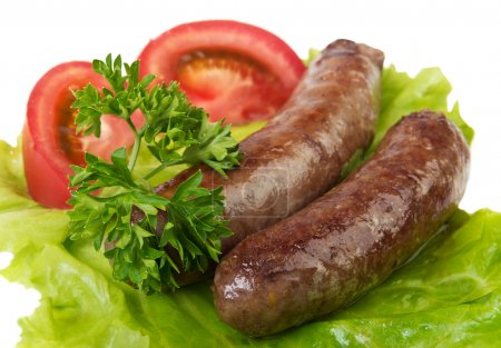 Grilled sausages on white background...