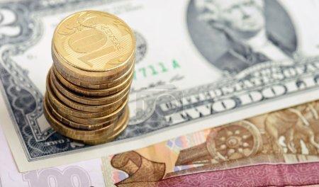 ussians coins on american dollar bill