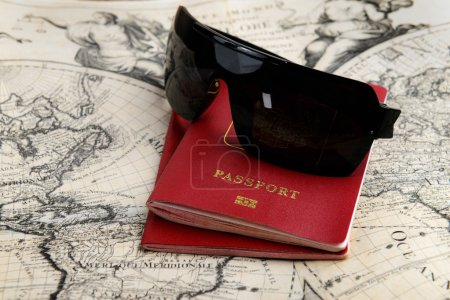 passports and sunglasses