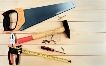 Photo for Assorted work tools on wooden background - Royalty Free Image