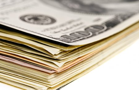 Photo for Stack of dollar banknotes macro view isolated on white - Royalty Free Image