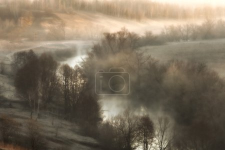 Surreal landscape with river mist