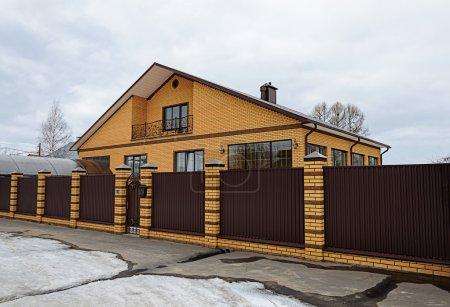 Modern yellow brick house with balcony