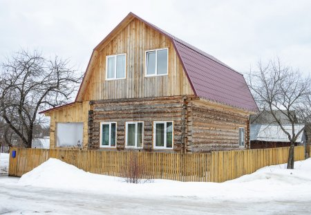 Rural wooden house in winter