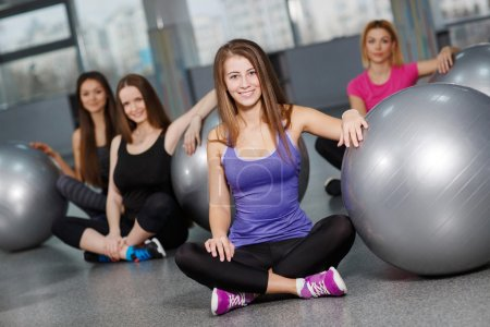 Beautiful girls in the fitness centre with exercise balls